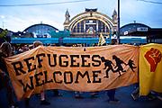 Frankfurt am Main | 05 July 2014<br /> <br /> Am Samstag (05.07.2014) demonstrierten in Frankfurt am Main etwa 250 Menschen aus der linksradikalen Szene gegen die deutsche Fl&uuml;chtlingspolitik, gegen Abschiebungen und f&uuml;r das Bleiberecht gefl&uuml;chteter Menschen in Deutschland und anderswo.<br /> Hier: Die Demo vor dem Hauptbahnhof Frankfurt, Transparent &quot;Refugees Welcome&quot;.<br /> <br /> [Foto honorarpflichtig, kein Model Release]<br /> <br /> &copy;peter-juelich.com