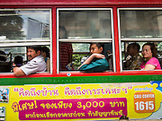 "23 AUGUST 2013 - BANGKOK, THAILAND:    Passengers ride a public bus in Bangkok. Thailand entered a ""technical"" recession this month after the economy shrank by 0.3% in the second quarter of the year. The 0.3% contraction in gross domestic product between April and June followed a previous fall of 1.7% during the first quarter of 2013. The contraction is being blamed on a drop in demand for exports, a drop in domestic demand and a loss of consumer confidence. At the same time, the value of the Thai Baht against the US Dollar has dropped significantly, from a high of about 28Baht to $1 in April to 32THB to 1USD in August.    PHOTO BY JACK KURTZ"