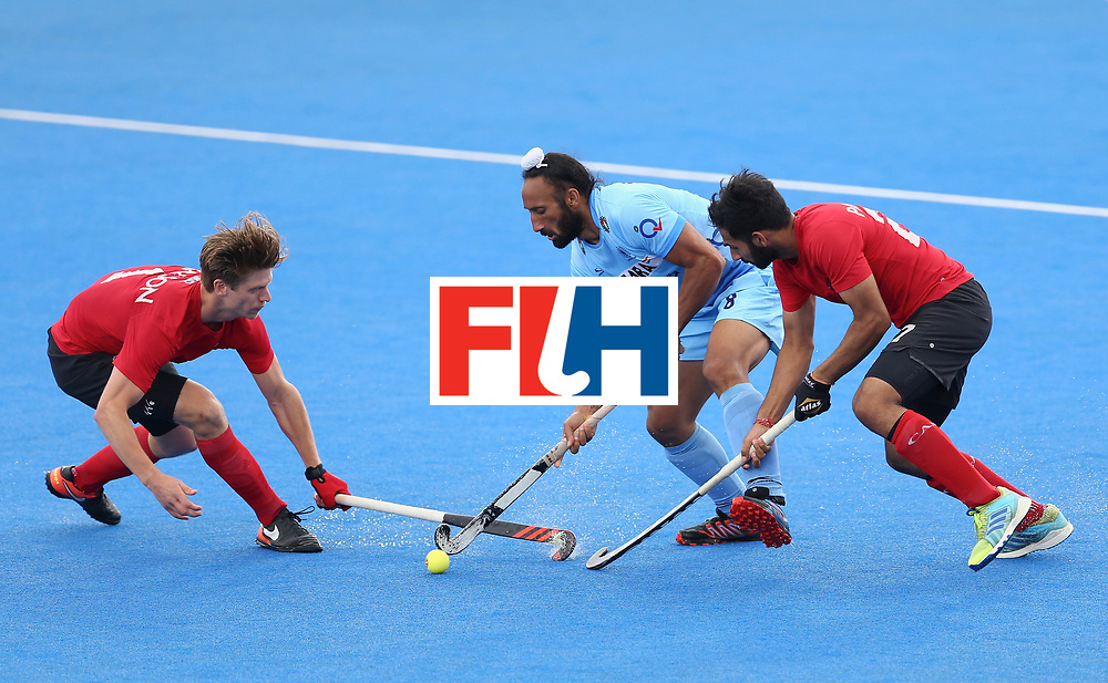 LONDON, ENGLAND - JUNE 25:  Sardar Singh of India battles for possession with Foris Van Son of Canada and Sukhi Panesar of Canada during the 5th/6th place match between India and Canada on day nine of the Hero Hockey World League Semi-Final at Lee Valley Hockey and Tennis Centre on June 25, 2017 in London, England.  (Photo by Steve Bardens/Getty Images)