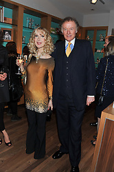 RICHARD & BASIA BRIGGS at the Linley Christmas party at Linley, 60 Pimlico Road, London on 20th November 2012.