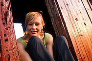 Portrait of a young woman in an old railroad yard near Boulder, Colorado