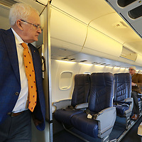 Larry Decker, left, checks out the aisle and leg room between the seats of the ERJ-135 for Contour Airlines that begin service in April for the Tupelo to Nashville route.
