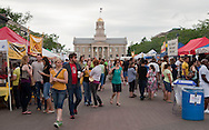 People visit the many food booths at Iowa Arts Festival in Iowa City on Saturday, June 5, 2010. Over 125 artists had booths at the event which runs through Sunday. Other activities include live music, children's activities, and food booths.