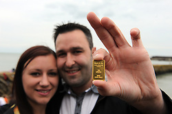 "© Licensed to London News Pictures. 30/08/2014<br /> Kirsty Henderson age 26 and Kevin Wood age 28 from Canterbury are the finders of the first declared gold bar in Folkestone,Kent. <br /> Folkestone Gold Beach.<br /> £10,000 of buried treasure at Outer Harbour beach near Sunny Sands, Folkestone,Kent.<br /> The installation, entitled ""Folkestone Digs"", is funded by Bristol-based designers Situations and the idea for the project came from Berlin-based artist Michael Sailstorfer.<br /> The small gold bars - similar to a dog tag - come in two sizes, worth around £250 and £500.<br /> <br /> (Byline:Grant Falvey/LNP)"