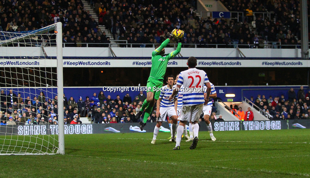 28 December 2014. Premiership. Queens Park Rangers v Crystal Palace.<br /> QPR goalkeeper Rob Green leaps to successfully intercept the ball.<br /> Photo: Charlotte Wilson