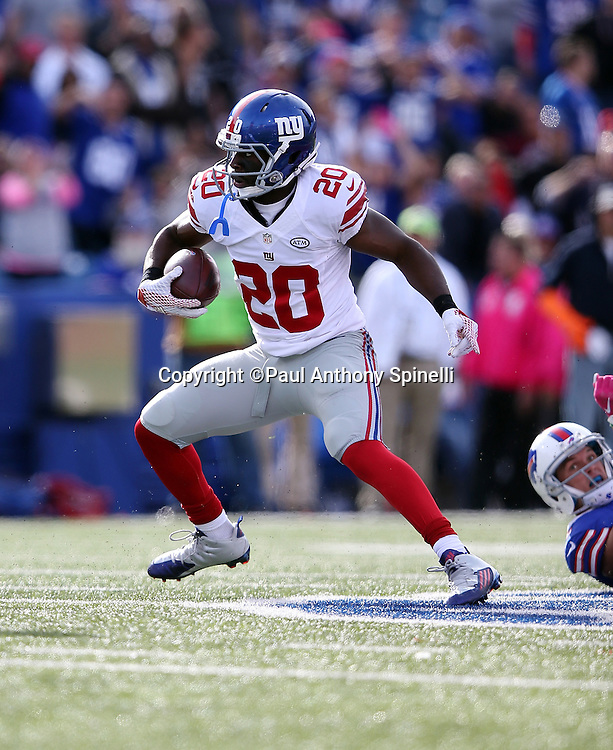 New York Giants cornerback Prince Amukamara (20) runs with the ball after recovering a late fourth quarter fumble that effectively ices the win during the 2015 NFL week 4 regular season football game against the Buffalo Bills on Sunday, Oct. 4, 2015 in Orchard Park, N.Y. The Giants won the game 24-10. (©Paul Anthony Spinelli)