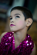 """Kafille is 6 years old. His mother had noticed since he was 3 years old, he already behaved as a little girl, showing signs of being feminine. His older brother, Aekachai, 23, is a ladyboy, and Kafille was definitely influenced by him..As her mother said: """"we can't do anything, he has to follow his heart and has to live his life the way he wants to""""<br /> Although the terms """"kathoey"""" or """"ladyboy"""" are rather ambiguous, simply put, both terms refer to a male who dresses as and adopts the mannerisms and identity of a woman. Though the term is often translated as """"transgender"""", transgender is rarely used in Thailand. Instead Thais use the term kathoey. This term can now also be used to refer to any male homosexual and was originally used to refer to intersex people. Due to this term becoming so broad, many choose to use the English word to explain a homosexual male dressing as a woman as a """"ladyboy"""". The term can also be meant as an insult, especially to those who are trying to alter their identity. Ladyboys suggest that they are still men who are merely dressed as women. The term is used rather loosely at times and can be used to refer to any male who possesses feminine qualities. Personally most of kathoeys prefer to call themselves """"a transformed goddess"""" or """"a second type of woman"""".<br /> <br /> Kathoeys are numerous in Thailand and are seemingly accepted by society, not only in the cities but in the countryside as well. Thai Buddhism does not specifically regard homosexuality as a sin and has no specific prohibitions regarding the lifestyle. However, acceptance of kathoeys is still grudging in many corners of Thai society. Katheoy have not yet attained equal status with those who are not transgender, and restrictions come with the identity. Katheoy cannot officially change their birth sex on birth certificates or passports, meaning they cannot marry someone of the same sex (even if they identify with a different gender). © Jean-Michel Clajot © Jean-Michel Clajot"""
