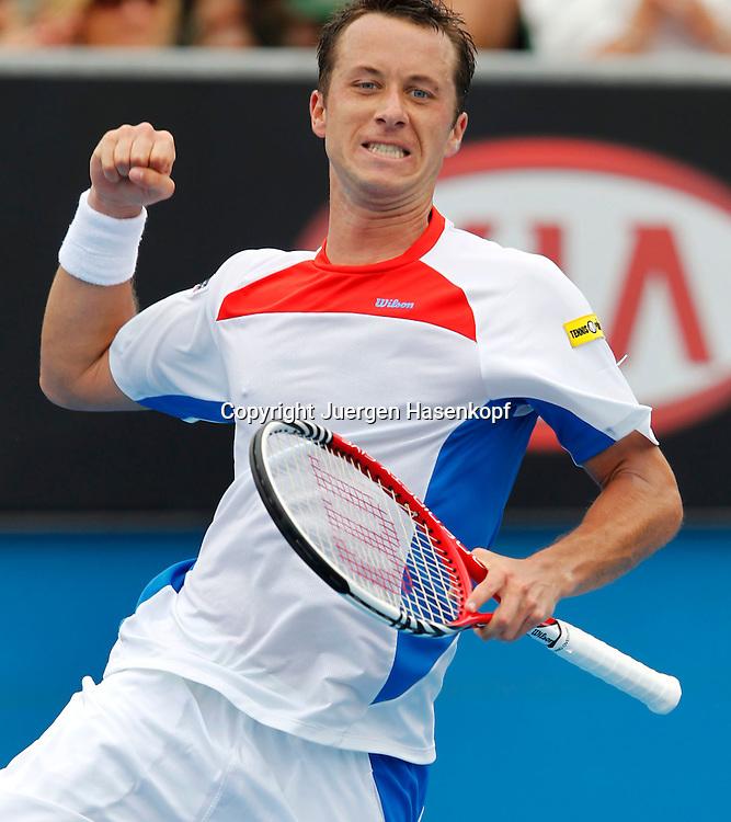 Australian Open 2012, Melbourne Park,ITF Grand Slam Tennis Tournament,Philipp Kohlschreiber (GER) macht die Faust und jubelt nach seinem Sieg,Jubel,Emotion,Einzelbild,Halbkoerper,Hochformat,