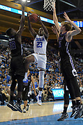 Nov 15, 2017; Los Angeles, CA, USA; UCLA Bruins guard Prince Ali (23) is defended by Central Arkansas Bears forward Otas Iyekekpolor (13) and center Hayden Koval (15) during a NCAA basketball at Pauley Pavilion. UCLA defeated Central Arkansas 106-101 in overtime.