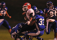 Water Valley's Kenon Kirkwood (33) and Water Valley's Adam Langham (12) make a tackle vs. Coffeeville in Water Valley, Miss. on Friday, August 26, 2011.