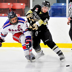 NORTH YORK, ON - Feb 9 : Ontario Junior Hockey League Game Action between North York Rangers Hockey Club and the Trenton Golden Hawks Hockey Club. D. Savory #16 of the Trenton Golden Hawks Hockey Club shoots the puck while being checked by Patrick Piacentini #2 of the North York Rangers Hockey Club.<br /> (Photo by Phillip Sutherland / OJHL Images)