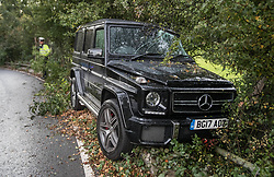 © Licensed to London News Pictures. 21/09/2017. London, UK. A policeman (L) looks at a Mercedes-Benz G-Class G63 as it lies damaged on the side of the road near Chelsea FC training ground.  The expensive 4X4 reportedly belongs to Chelsea midfielder Tiemoue Bakayoko who was returning home from training at 3.30PM today when he crashed on Blundel Lane.  Photo credit: Peter Macdiarmid/LNP