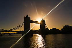 © Licensed to London News Pictures. 22/12/2016. LONDON, UK.  The sun rises behind Tower Bridge into clear sky later this morning. After a cold and foggy start to the day, London is now seeing bright and sunny weather today. Photo credit: Vickie Flores/LNP