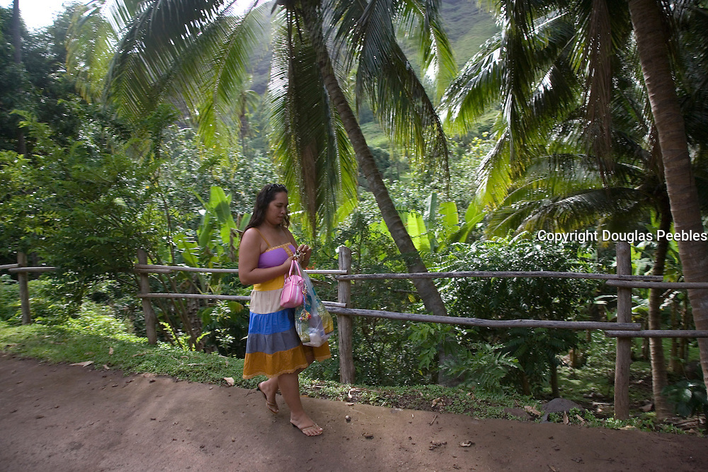 Woman wlking on road, Ua Huka, Marquesas Islands, French Polynesia, (Editorial use only)<br />