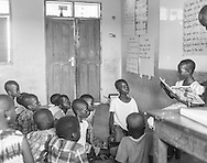 A student reads to her classmates during a reading camp provided by Baltimore, Maryland base non-profit Ghanaian Mothers Hope in Akramaman, Ghana, Thursday, August 6, 2015. Photo: Bryan Woolston / For GMHope.com