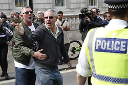 © Licensed to London News Pictures. 07/09/2019. London, UK. Far right protestors taunt Pro-EU demonstrators as they gather for a Stop the Coup protest in Whitehall, central London. Photo credit: Peter Macdiarmid/LNP