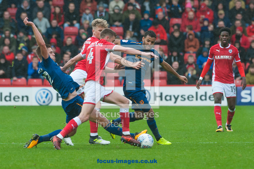 Markus Henriksen of Hull City attempts to tackle Joe Williams of Barnsley during the Sky Bet Championship match at Oakwell, Barnsley<br /> Picture by Matt Wilkinson/Focus Images Ltd 07814 960751<br /> 21/10/2017