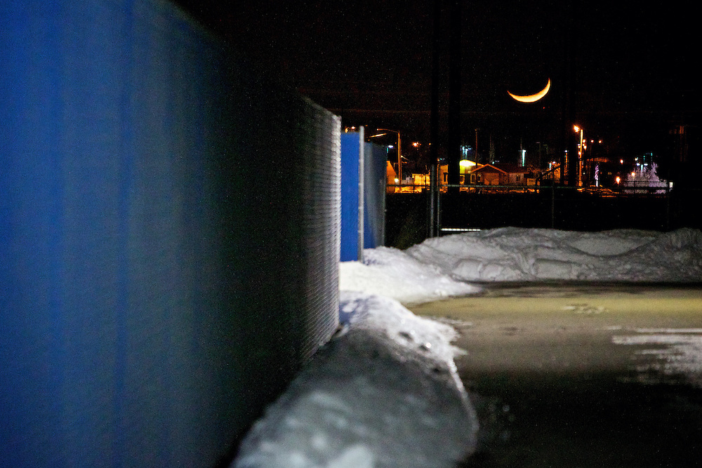 A crescent moon rises over the rooftops Thursday, Jan. 26, 2012 in Coeur d'Alene, Idaho.