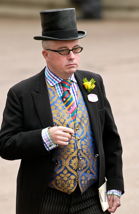 Race-goer in traditional Ascot fashion of top hat and tails at Royal Ascot Races, UK