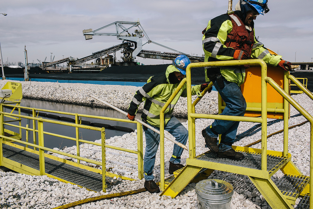 Mike Houchin and Nick Gainey take water samples from the outfall pond at Consol Energy's Baltimore Terminal in Maryland on March 6, 2014. They have to test water to make sure it is clear of any hazard before it is discharged from the terminal to Patapsco river.