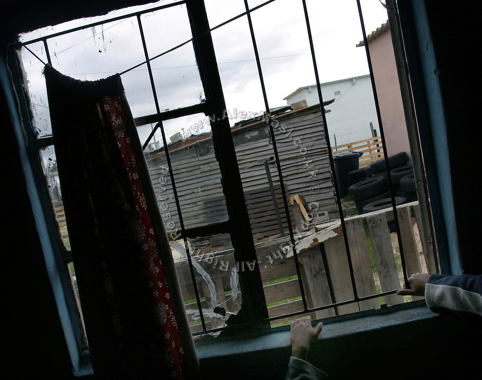 Shacks are seen from a window of Mama Ester's creche in Khayelitsha township, Cape Town, where over a million people live in the extreme poverty..