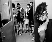 Quarters are tight in Memorial Stadium, so fighters and the ring girls have to share the limited space near the locker rooms before parading in front of the crowd opening night.