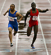 05/13/2009 - Jefferson's Marlon Miles (153) just edges out Madison's Donovan McFadden (192) during the men's 100 meter dash. The 5A PIL Varsity District Track Meet takes place at Lewis and Clark College....KEYWORDS:  City, Portland, high school, girls, boys, run, field, sports