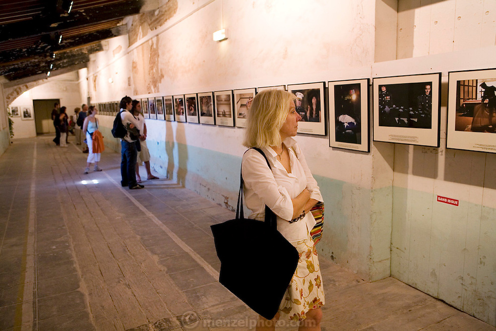 .Ruth Eichhorn views one of the many photo exhibits at Visa pour l'image International festival of photojournalism, held in Perpignan, France. MODEL RELEASED.