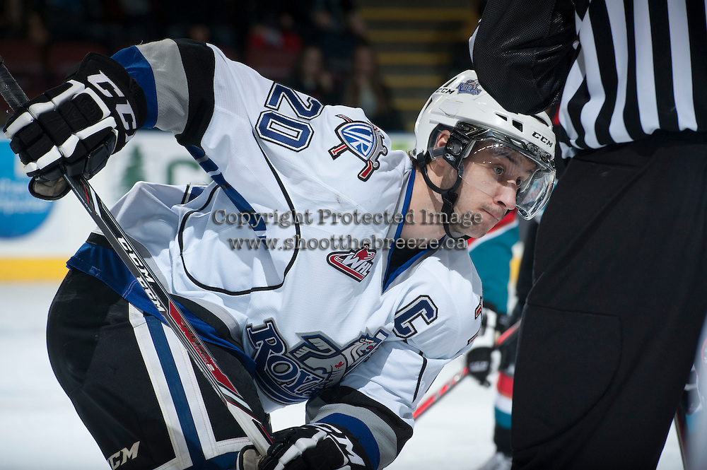 KELOWNA, CANADA - NOVEMBER 20: Logan Fisher #20 of the Victoria Royals faces off against the Kelowna Rockets on November 20, 2013 at Prospera Place in Kelowna, British Columbia, Canada.   (Photo by Marissa Baecker/Shoot the Breeze)  ***  Local Caption  ***