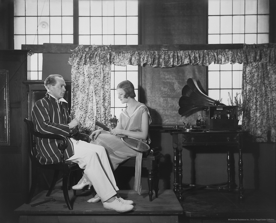 Joan Pickering and Theums Nell listening to an early Marconi wireless set, 1923