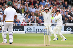 England's Stuart Broad celebrates as Liam Dawson (right) catches South Africa's Vernon Philander (left) during day two of the Second Investec Test match at Trent Bridge, Nottingham.