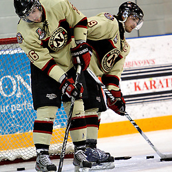 NEWMARKET, ON - Mar 7 : Ontario Junior Hockey League Playoff Game Action between the Whitby Fury and the Newmarket Hurricanes, Daniel Leavens #26 of the Newmarket Hurricanes and Chris Chiste #9 of the Newmarket Hurricanes clear the net during the pre-game warm-up..(Photo by Brian Watts / OJHL Images)