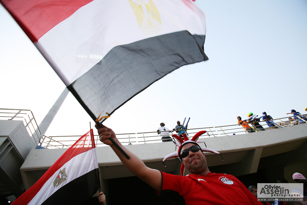 A fan of Egypt waves a flag prior to the Africa Cup of Nations final between Egypt and Cameroon in Accra, Ghana on February 10, 2008.