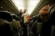 Ahmed El Fayed 27 ans originaire de Tanta en Egypte, ouvrier dans le Batiment en Libye a fui vers la Tunisie quand son patron lui a rendu son passeport avant de prendre la fuite vers une destination étrangère. Seule explication laissée:  les mois de Janvier et de Février ne seront pas payés. Dans l'avion qui le ramène au Caire. © Benjamin Girette/IP3 press