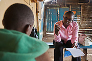 Anne talks to a young boy as part of an outreach clinic run by Action for children in conflict (AFCIC) based from Thika, Kenya. The main aim of the organisation is to keep the children off the streets with their families.