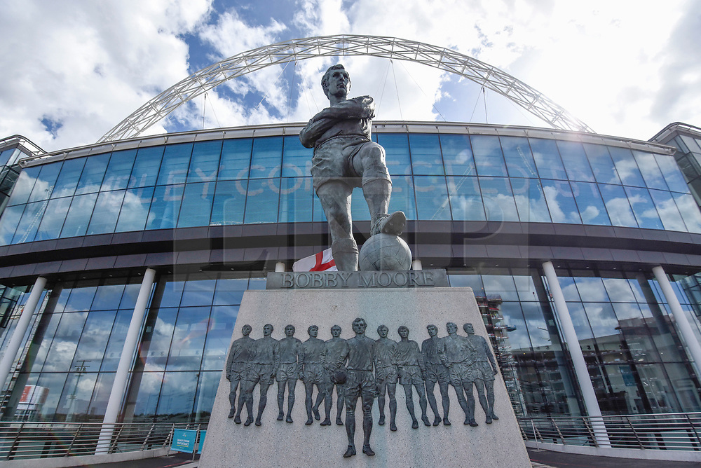 © Licensed to London News Pictures. 26/04/2018. LONDON, UK.  The statue of Bobby Moore outside Wembley Stadium.  It is reported that the Football Association (FA) has received a bid of GBP800m from Shahid Khan, owner of Fulham FC and the Jacksonville Jaguars NFL franchise, to purchase the stadium.  If the bid is successful, the FA will retain its organisational base at the stadium, but will open the way for the creation of the first NFL franchise located out of the United States.  Photo credit: Stephen Chung/LNP