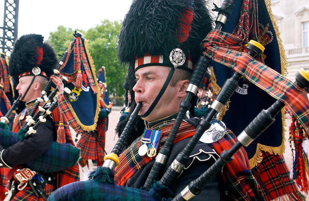 Scots Guards playing the bagpipes in a London Parade