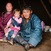 Family of Dukha (Tsaatan) reindeer herders in their ortz (teepee). Approximately 200 families comprise the Tsaatan or Dukha community in northwestern Mongolia, whose existence is intimately linked to their herds of reindeer. Photo © Robert van Sluis
