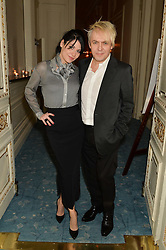 NICK RHODES and NEFER SUVIO at a party to celebrate the publication of The Romanovs 1613-1918 by Simon Sebag-Montefiore held at The Mandarin Oriental, 66 Knightsbridge, London on 2nd February 2016.
