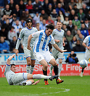 Picture by Graham Crowther/Focus Images Ltd. 07763140036.07/04/12.Alan Lee of Huddersfield is tackled by Danny Batth of Sheffield Wednesday during the Npower League 1 match at The Galpharm Stadium Stadium, Huddersfield.