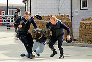 Anti-terrorist armed police training manoeuvre apprehending a 'suspect' in Belfast, Northern Ireland