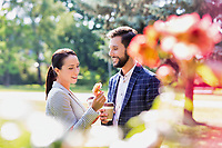 Portrait of young attractive business couple dating in park during break