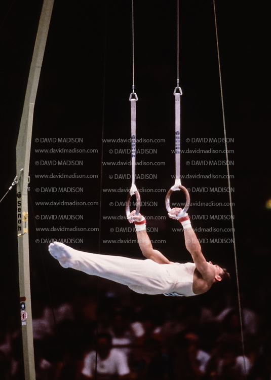SEOUL, SOUTH KOREA -  SEPTEMBER 1988:  Kevin Davis of the United States competes on the still rings during the Men's Gymnastics competition of the 1988 Olympic Games during September 1988 at the Olympic Gymnastics Hall in Seoul, South Korea.  (Photo by David Madison/Getty Images)