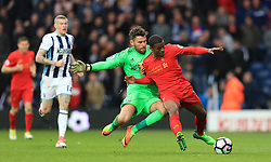 Liverpool's Georginio Wijnaldum (right) battles with West Bromwich Albion goalkeeper Ben Foster near the halfway line in the dying moments of the game during the Premier League match at The Hawthorns, West Bromwich.