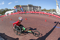 Men's wheelchair athletes pass Buckingham Palace and the Victoria Memorial as they approach the finish of the Virgin Money London Marathon 2014<br /> on Sunday 13 April 2014<br /> Photo: Dave Shopland/Virgin Money London Marathon<br /> media@london-marathon.co.uk