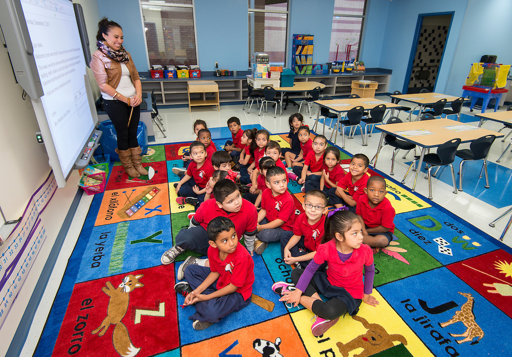 Students attend the first first day of class at the new Sherman Elementary School, December 2, 2013.