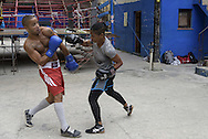 Namibia hopes to bet an example also for Cuban authorities to<br /> recognize women&rsquo;s boxing as a sport discipline and, although<br /> no longer be able to compete for the limits of his age, he<br /> hopes to give contribution as a coach in the future.<br /> <br /> The Cuban boxing has a centennial long prestigious history written by exceptional champions, artists of the ring, whose legendary exploits , continue to live in the stories of fans. In 1962 Cuba had abolished professionalism in sports. Two years ago, driven by economic interests and attempt to stop the bleeding of athletes on the run from the island, sports authorities have announced participation in world boxing championship, the World Series of Boxing (WSB), which are not however a professional circuit because they remain part of the Olympic boxing. Thanks to a law passed a few years ago, with new economic conditions for the Cuban athletes, now, in addition to the contributions they receive from the state, the Cuban boxers will earn from their sport, 80% of the proceeds from participation in<br /> international sporting events. Another revolution in the land of revolutionary socialist utopia , now more and more on the road of the disintegration waiting for another revolution in the Cuban boxing that will allow women to have a women&rsquo;s boxing team. Revolution for which for years has fought Namibia Flores whose dream is to participate in the Olympics with the colors of his country. A fight against time for the forty Namibia Flores. A dream that will probably remain so for reached the age limit.<br /> Namibia has refused to fight for the US teams. Most likely it will not fight the next Olympics in Rio but it is determined to help future Cuban fighters to practice the sport which they love.