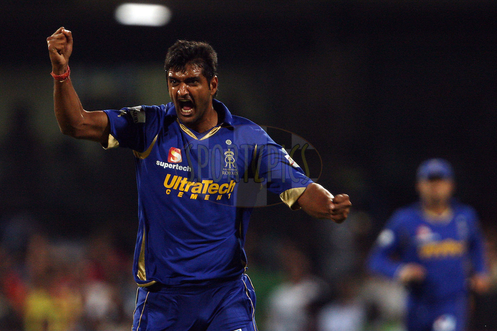 Pankaj Singh celebrates the wicket of Chris Gayle during match 18 of the the Indian Premier League ( IPL) 2012  between The Royal Challengers Bangalore and the Rajasthan Royals held at the M. Chinnaswamy Stadium, Bengaluru on the 15th April 2012..Photo by Jacques Rossouw/IPL/SPORTZPICS
