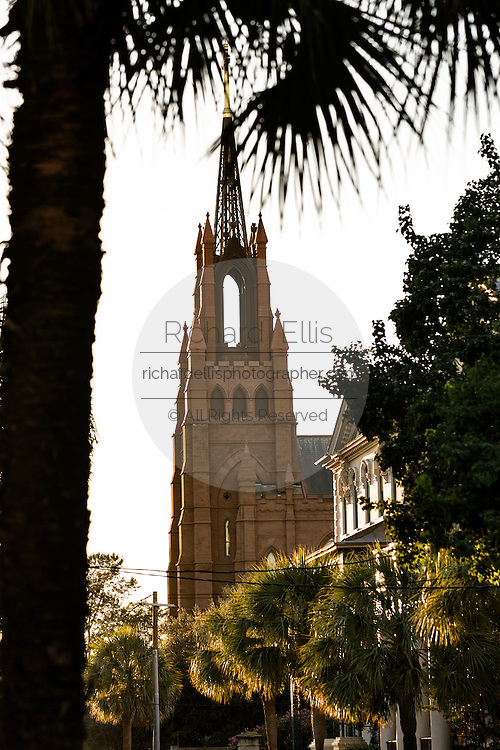 Sunset along Broad Street with the Cathedral of St. John the Baptist in historic Charleston, SC.