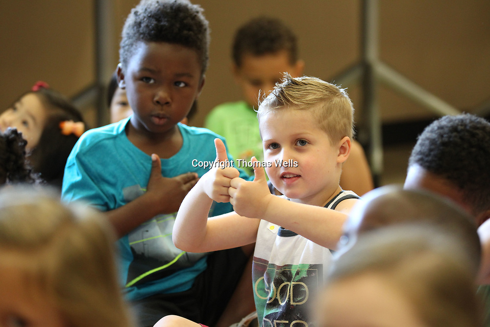 "Bentley Shook, 5, gives two ""thumbs up"" for the book The Night Before Kindergarten as he and other children go through a school day at Joyner Elementary as they hold their ""splash into kindergarten"" day on Wednesday."